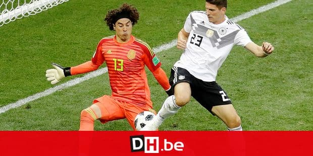 Mexico goalkeeper Guillermo Ochoa blocks Germany's Mario Gomez during the group F match between Germany and Mexico at the 2018 soccer World Cup in the Luzhniki Stadium in Moscow, Russia, Sunday, June 17, 2018. (AP Photo/Michael Probst)