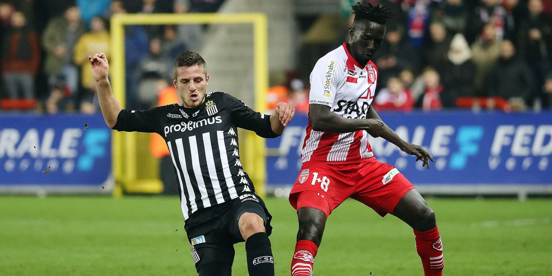 Charleroi's Steeven Willems and Mouscron's Mbaye Leye fight for the ball during a soccer match between Royal Excel Mouscron and Sporting Charleroi, Friday 01 February 2019 in Mouscron, on day 24th of the 'Jupiler Pro League' Belgian soccer championship season 2018-2019. BELGA PHOTO VIRGINIE LEFOUR