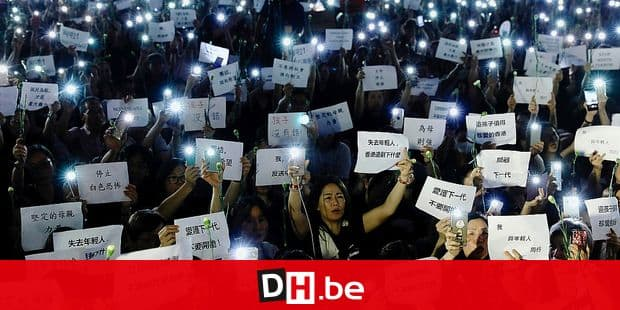 """Hundreds of mothers holding placards, some of which read """"If we lose the young generation, what's left of Hong Kong"""", and lit smartphones protest against the amendments to the extradition law in Hong Kong on Friday, June 14, 2019. Calm appeared to have returned to Hong Kong after days of protests by students and human rights activists opposed to a bill that would allow suspects to be tried in mainland Chinese courts. (AP Photo/Vincent Yu)"""