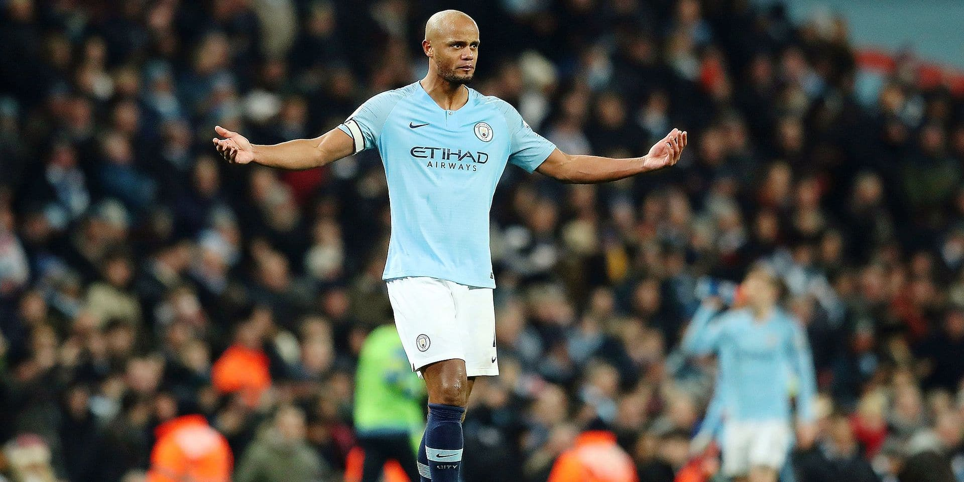 Manchester City's Vincent Kompany gestures to his teammates during their English Premier League soccer match between Manchester City and Liverpool at the Ethiad stadium, Manchester England, Thursday, Jan. 3, 2019. (AP Photo/Jon Super)