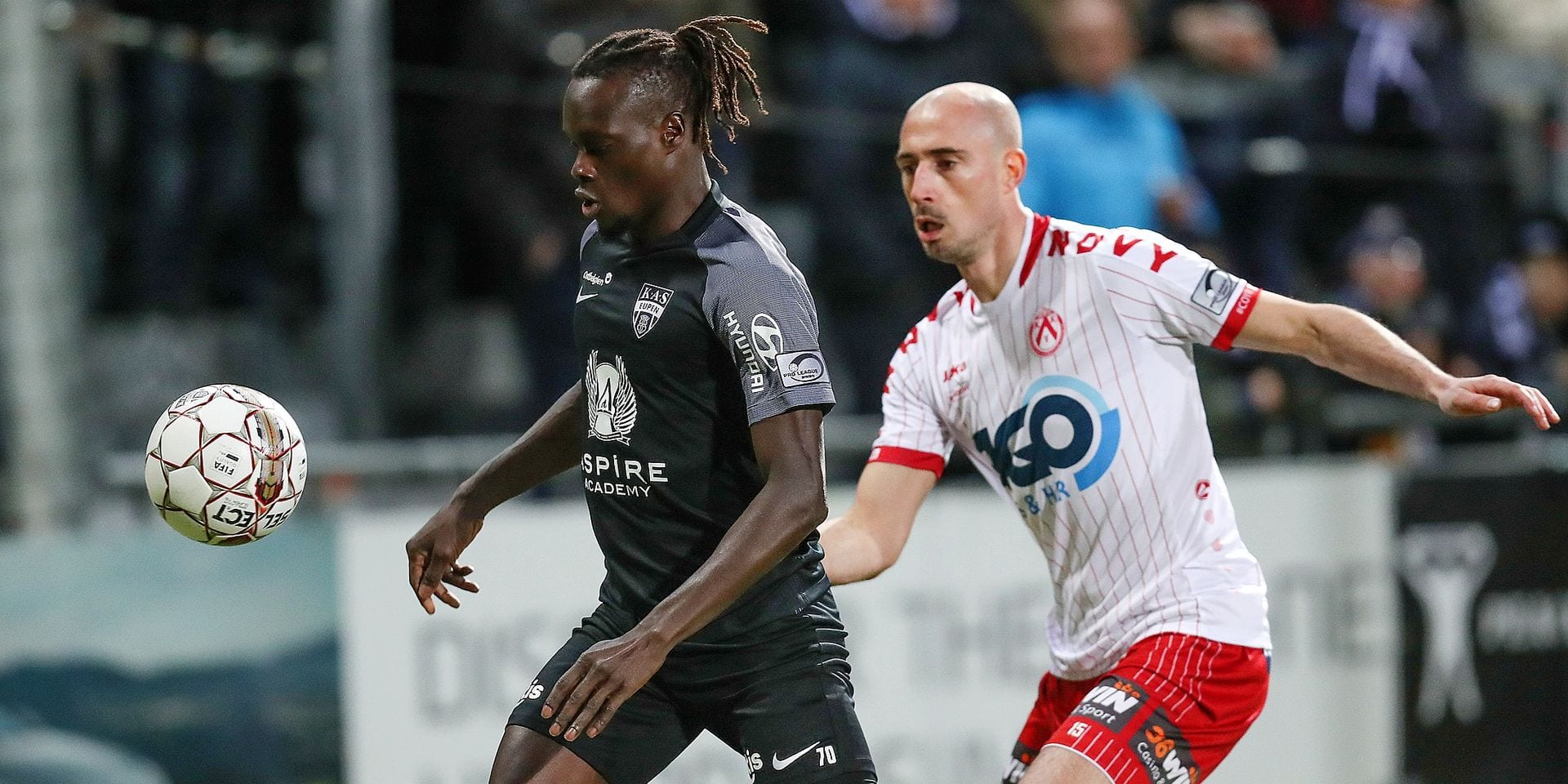 Eupen's Mamadou Fall and Kortrijk's Christophe Lepoint fight for the ball during a soccer match between KAS Eupen and KV Kortrijk, Saturday 09 February 2019 in Eupen, on the 25th day of the 'Jupiler Pro League' Belgian soccer championship season 2018-2019. BELGA PHOTO BRUNO FAHY