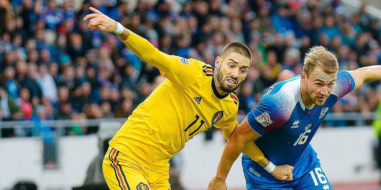 Iceland's Runar Mar Sigurjonsson (R) and Belgium's Yannick Carrasco vie for the ball during the Nations League football match between Iceland and Belgium on September 11, 2018, in Reykjavik, Iceland. (Photo by Haraldur Gudjonsson / AFP)
