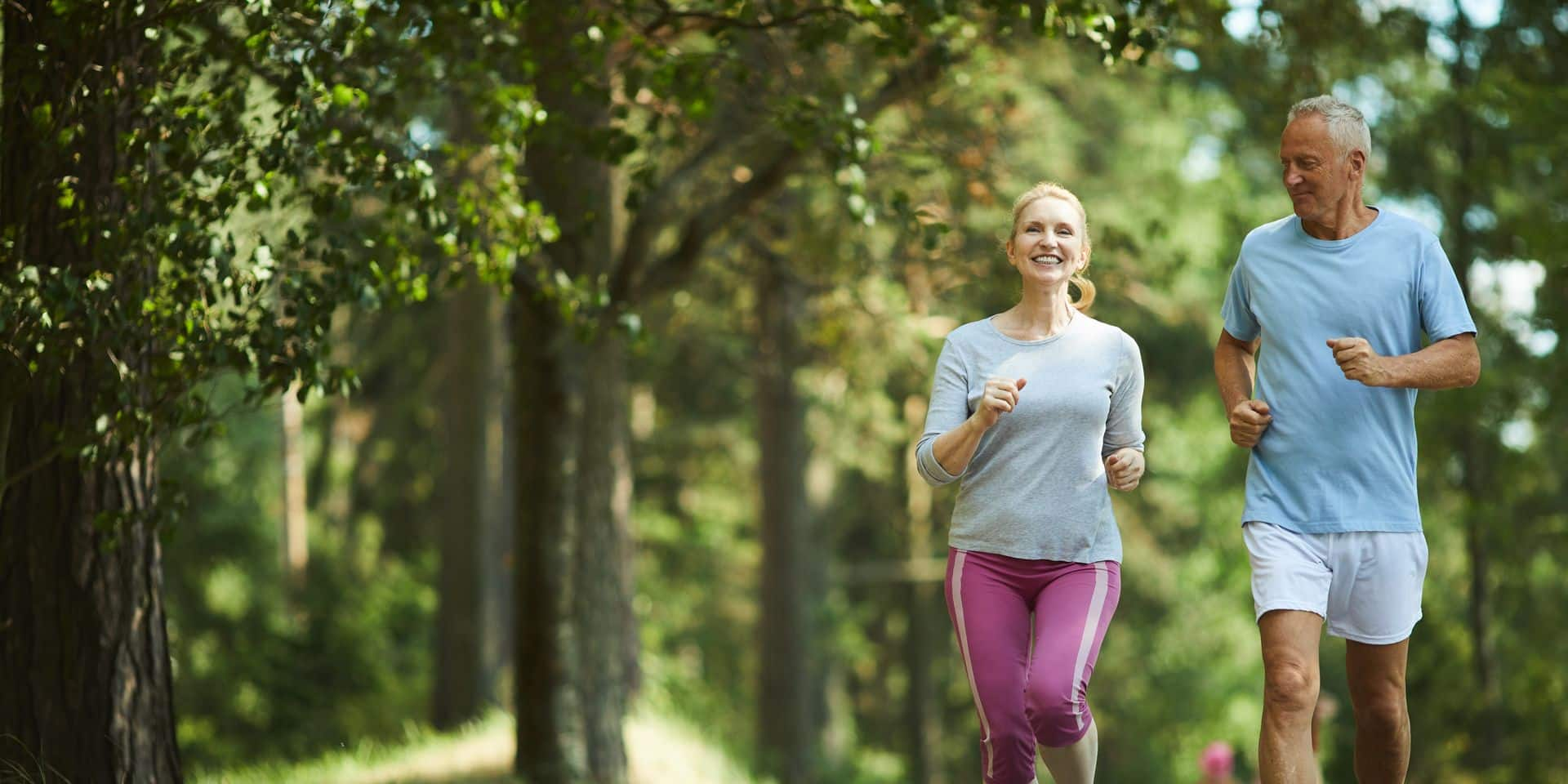 Active,And,Healthy,Aged,Couple,Running,In,Natural,Environment,On