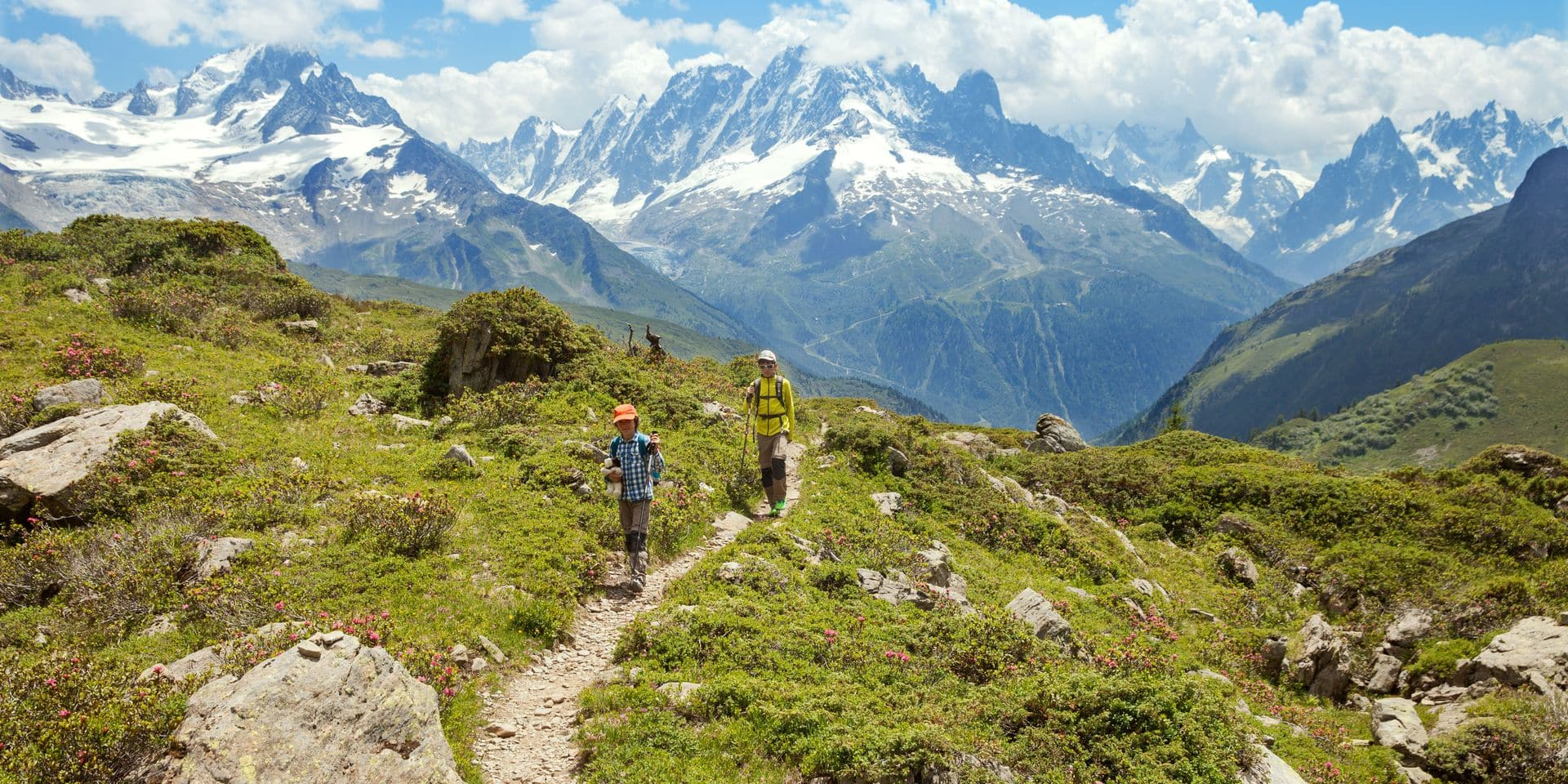 Two,Boys,Are,Hiking,In,Summer,Mountains,,France