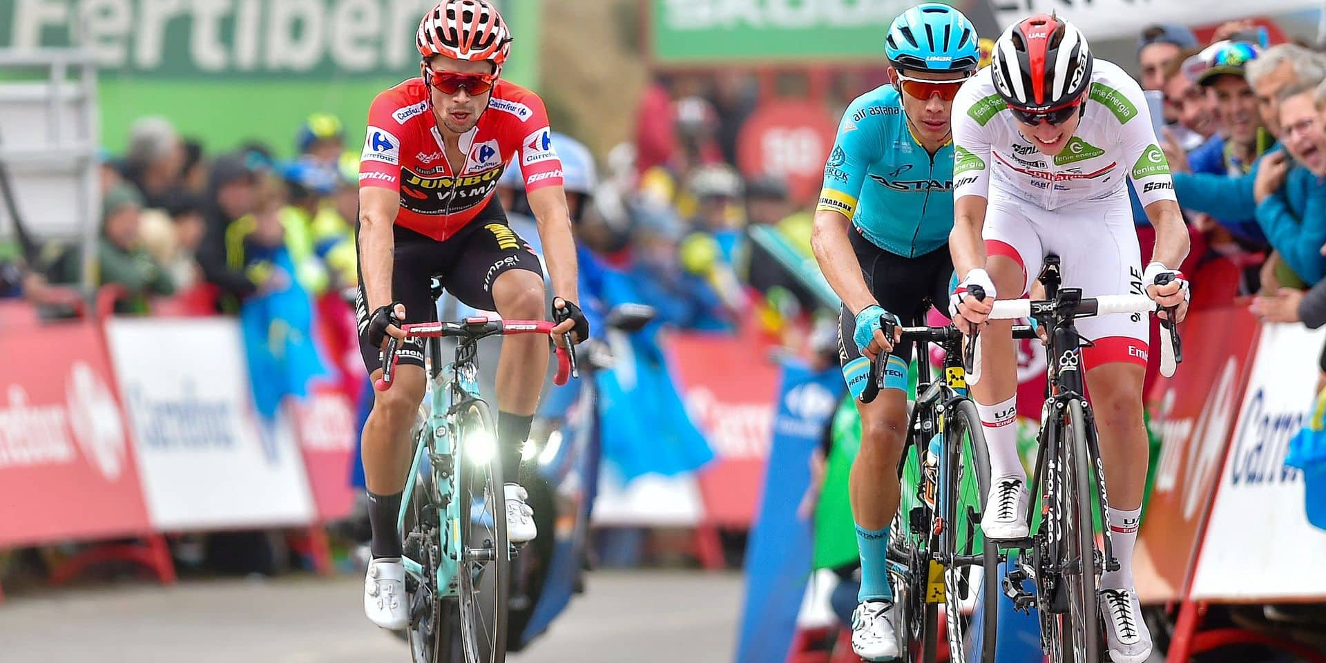Team UAE Emirates rider Slovenia's Tadej Pogacar (R) leads Team Astana rider Colombia's Miguel Angel Lopez (C) and Team Jumbo rider Slovenia's Primoz Roglic (L) to the finish line of the 16th stage of the 2019 La Vuelta cycling Tour of Spain, a 144,4 km race from Pravia to the Alto de la Cubilla in Lena on September 9, 2019. (Photo by Ander GILLENEA / AFP)