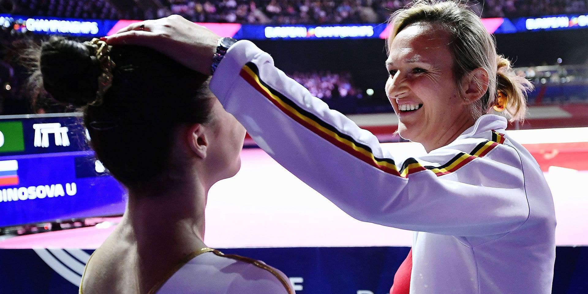 Belgian gymnast Nina Derwael and gymnastics coach Marjorie Heuls celebrate after Derwael won the women's uneven bars final at the artistic gymnastics event at the European Championships, in Glasgow, Scotland, Sunday 05 August 2018. European championships of several sports will be held in Glasgow from 03 to 12 August. BELGA PHOTO ERIC LALMAND