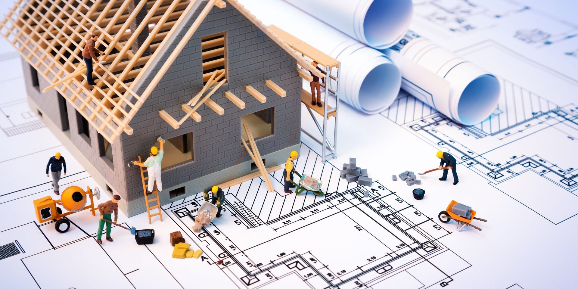 Building,House,On,Blueprints,With,Worker,-,Construction,Project