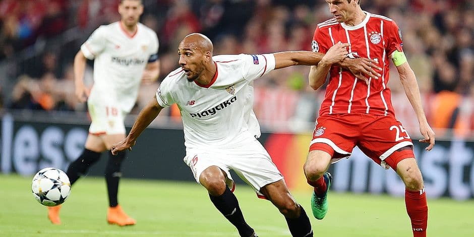 Bayern Munich's Thomas Mueller and Sevilla's Steven Nzonzi battle for the ball during the UEFA Champions League soccer match between Bayern Munich and FC Sevilla at the Allianz Arena, in Munich, Germany, 11 April 2018. Photo: Sven Hoppe/dpa