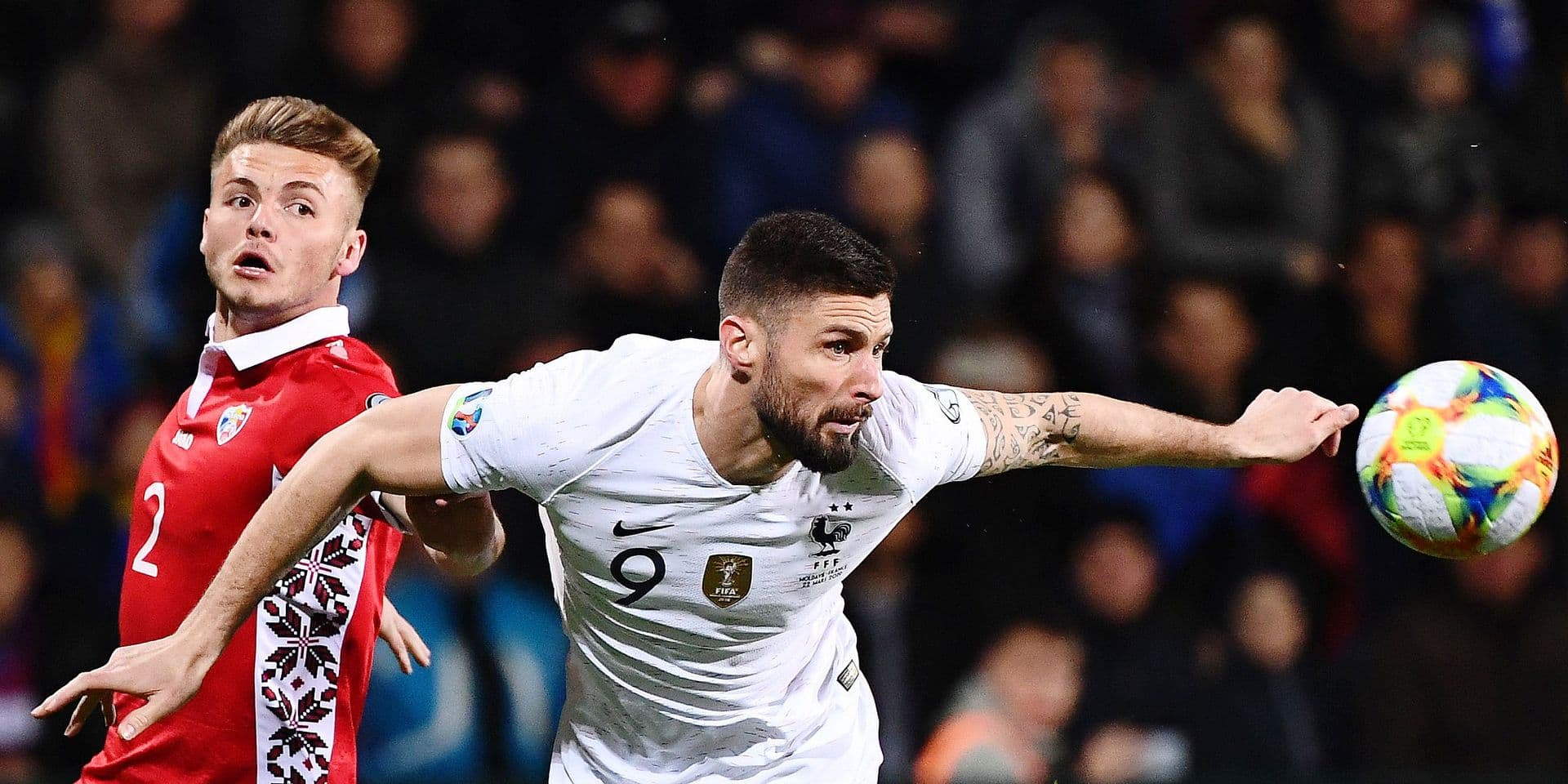 Moldova's defender Oleg Reabciuk (L) vies with France's forward Olivier Giroud (R) during the Euro 2020 qualifying football match between Moldova and France, on March 22, 2019 at Zimbru stadium in Chisinau. (Photo by FRANCK FIFE / AFP)