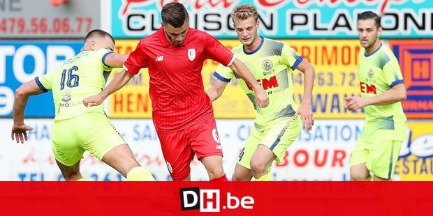 Sprimont's Alexandre Manzo and Standard's Julien Demarteau fight for the ball during a friendly game, the first of the new season 2018-2019 for Standard de Liege, against FRCB Sprimont, in Sprimont, Saturday 23 June 2018. BELGA PHOTO VIRGINIE LEFOUR