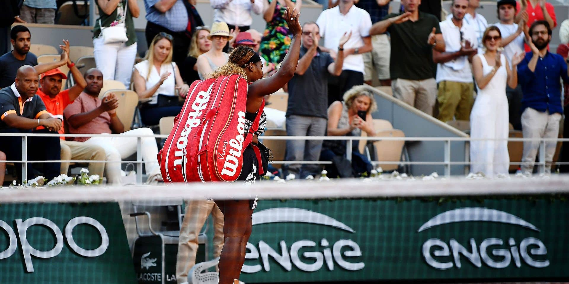 Serena Williams of the US waves as she leaves the court at the end of her women's singles third round match against Sofia Kenin of the US, on day seven of The Roland Garros 2019 French Open tennis tournament in Paris on June 1, 2019. (Photo by Anne-Christine POUJOULAT / AFP)