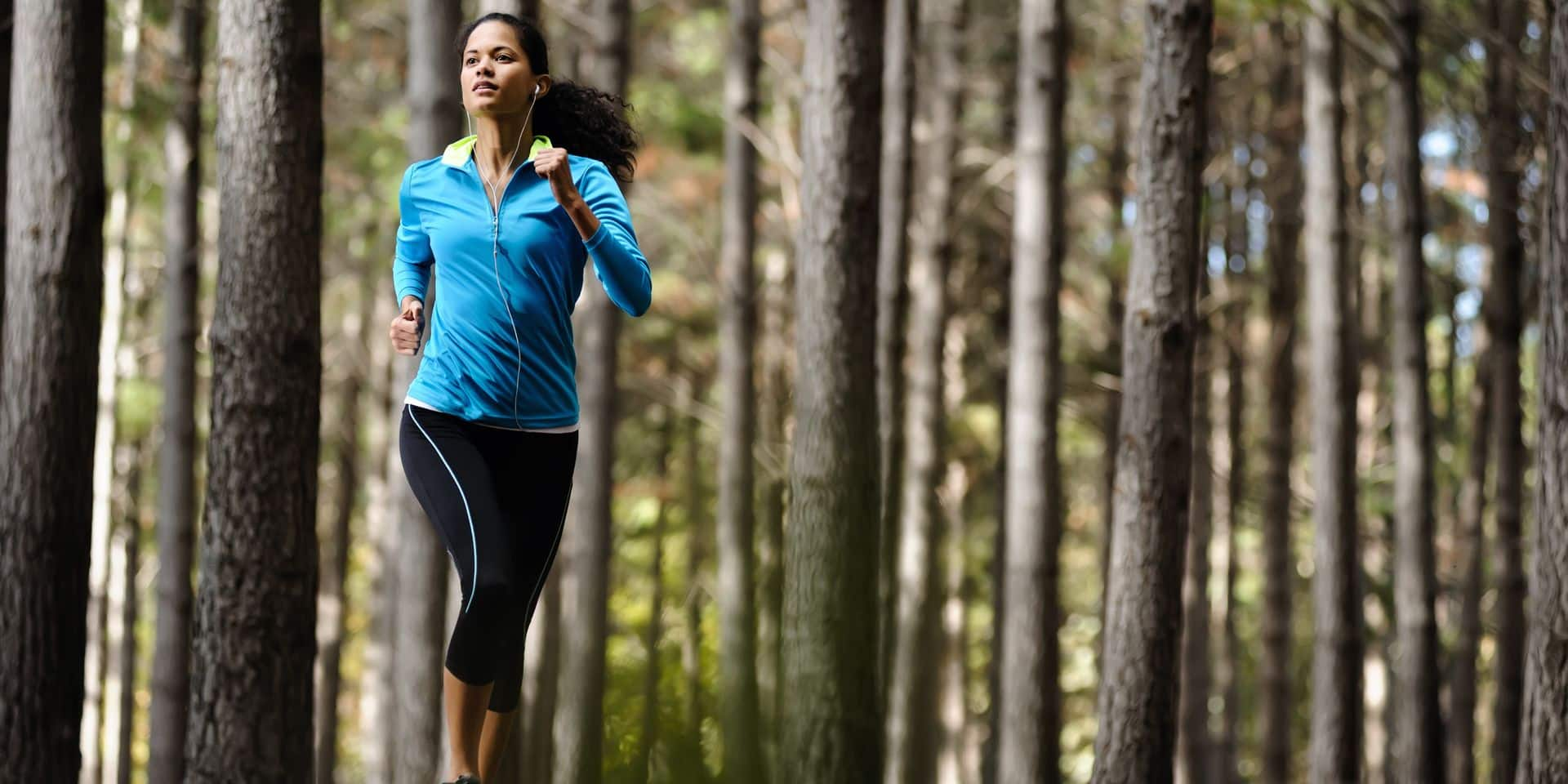 Woman,Running,In,Wooded,Forest,Area,,Training,And,Exercising,For