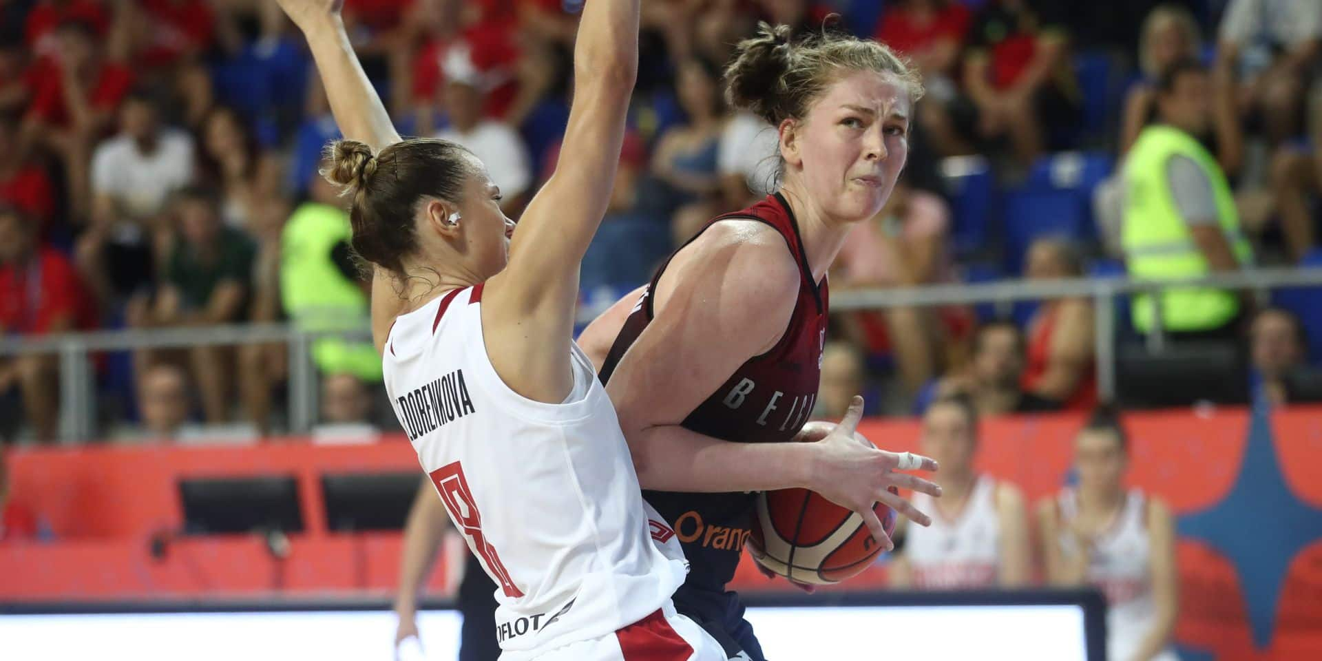 Russia's Ekaterina Fedorenkova and Belgian Cats Emma Meesseman fight for the ball during the first game in the group stage, group D, between Belgian Cats and Russia national team, in Zrenjanin, Serbia, in marge of the group stage of the women EuroBasket basketball European championships, organised in Latvia and Serbia, Thursday 27 June 2019. BELGA PHOTO VIRGINIE LEFOUR