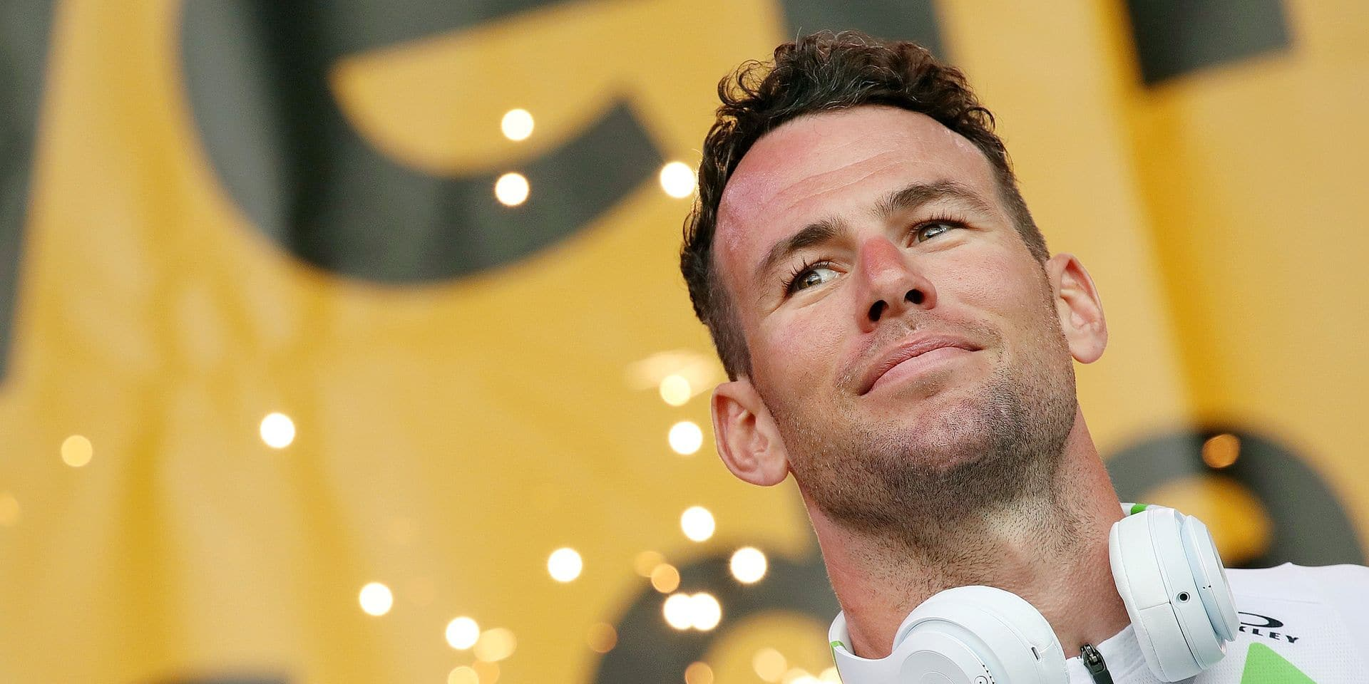 FILE - In this Thursday, July 5, 2018 file photo, Britain's sprinter Mark Cavendish listens during the Tour de France cycling race team presentation in La Roche-sur-Yon, Vendee region, France, ahead of Saturday's start of the race. Mark Cavendish will take an indefinite break from cycling after being diagnosed with the Epstein-Barr virus for the second time in his career. (AP Photo/Christophe Ena, File)