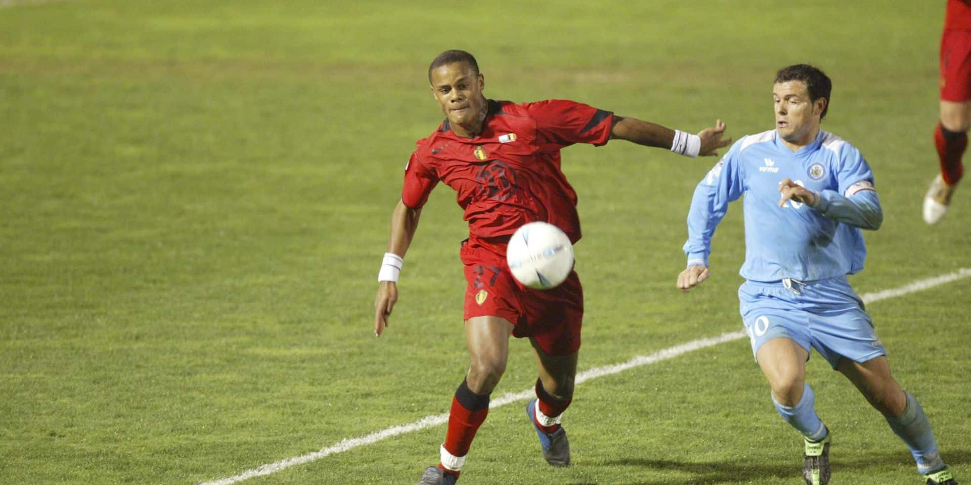 BRU157 - 20050330 - SERRAVALLE, SAN MARINO: Red Devils' Vincent Kompany (L) and San Marino's Andy Selva (R) fight for the ball during the 2006 World Cup qualifying soccer match Belgium vs San Marino, Wednesday 30 March 2005 at the Stadio Di Serravalle in San Marino. Belgium won 1-2. BELGA PHOTO FRANCOIS WALSCHAERTS