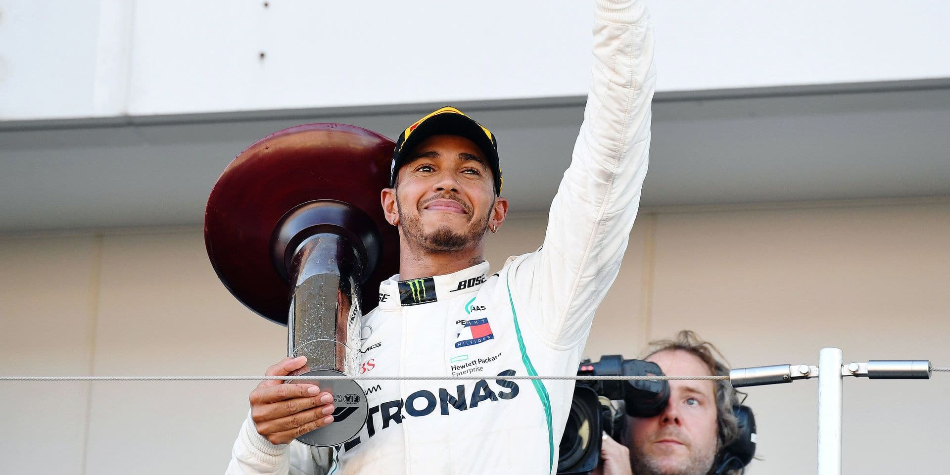 Mercedes' British driver Lewis Hamilton celebrates on the podium after his victory in the Formula One Japanese Grand Prix at Suzuka on October 7, 2018. (Photo by Toshifumi KITAMURA / AFP)