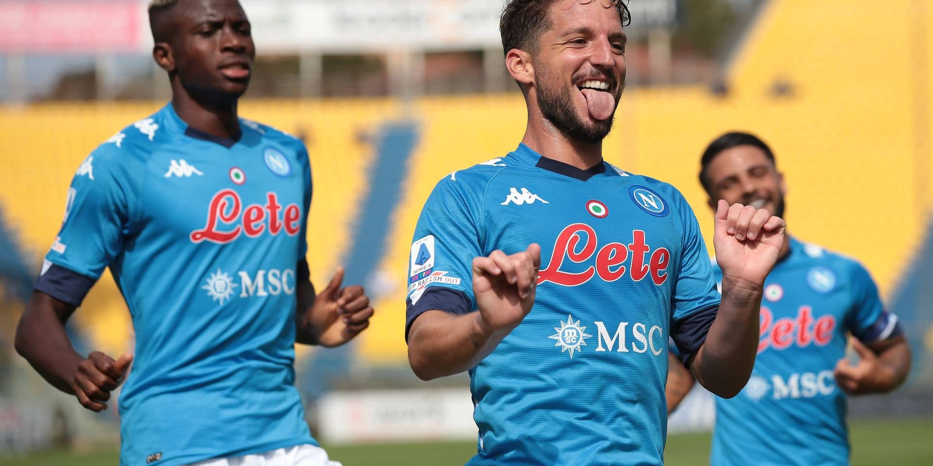 Dries Mertens of SSC Napoli celebrates with team mates after scoring to give the side a 1-0 lead during the Serie A mat