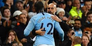 Manchester City's Spanish manager Pep Guardiola (R) embraces Manchester City's Ivorian midfielder Yaya Toure as he is substituted during the English Premier League football match between Manchester City and Brighton and Hove Albion at the Etihad Stadium in Manchester, north west England, on May 9, 2018. / AFP PHOTO / Paul ELLIS / RESTRICTED TO EDITORIAL USE. No use with unauthorized audio, video, data, fixture lists, club/league logos or 'live' services. Online in-match use limited to 75 images, no video emulation. No use in betting, games or single club/league/player publications. /