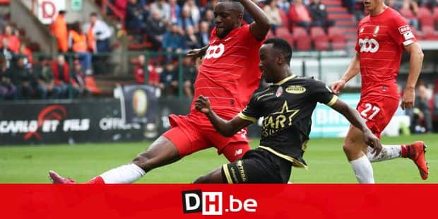 Standard's Merveille Bope Bokadi and Mouscron's Fabrice Olinga fight for the ball during a soccer match between Standard de Liege and Excel Mouscron, Sunday 18 August 2019 in Liege, on the fourth day of the 'Jupiler Pro League' Belgian soccer championship season 2019-2020. BELGA PHOTO VIRGINIE LEFOUR