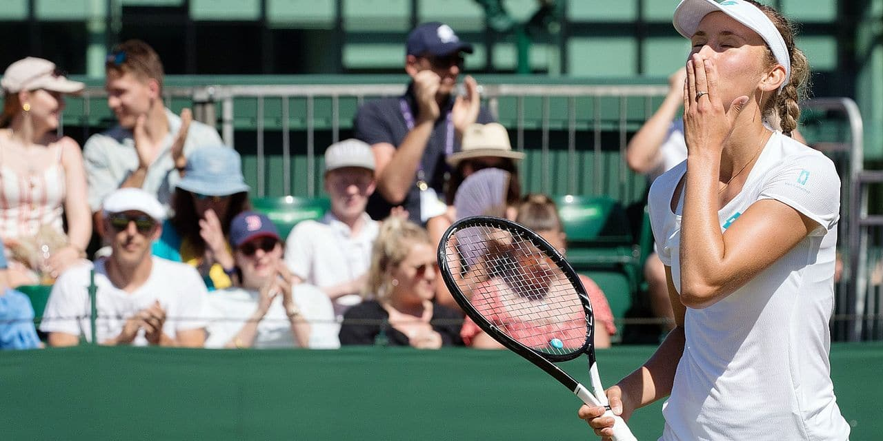 Belgian Elise Mertens celebrates after winning the game between Romanian Monica Niculescu (WTA 111) and Belgian Elise Mertens (WTA 21) in the women's singles second round at the 2019 Wimbledon grand slam tennis tournament at the All England Tennis Club, in south-west London, Britain, Thursday 04 July 2019. BELGA PHOTO BENOIT DOPPAGNE