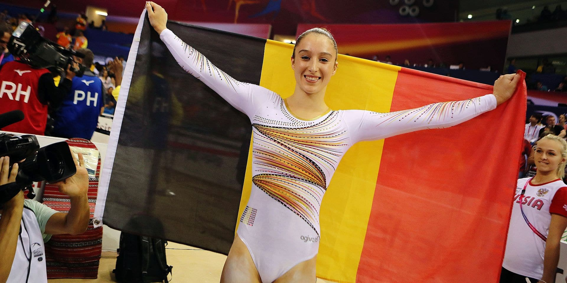 Nina Derwael of Belgium celebrates after winning gold on the uneven bars during day nine of the 2018 FIG Artistic Gymnastics Championships at the Aspire Dome on November 2, 2018 in Doha, Qatar. (Photo by KARIM JAAFAR / AFP)