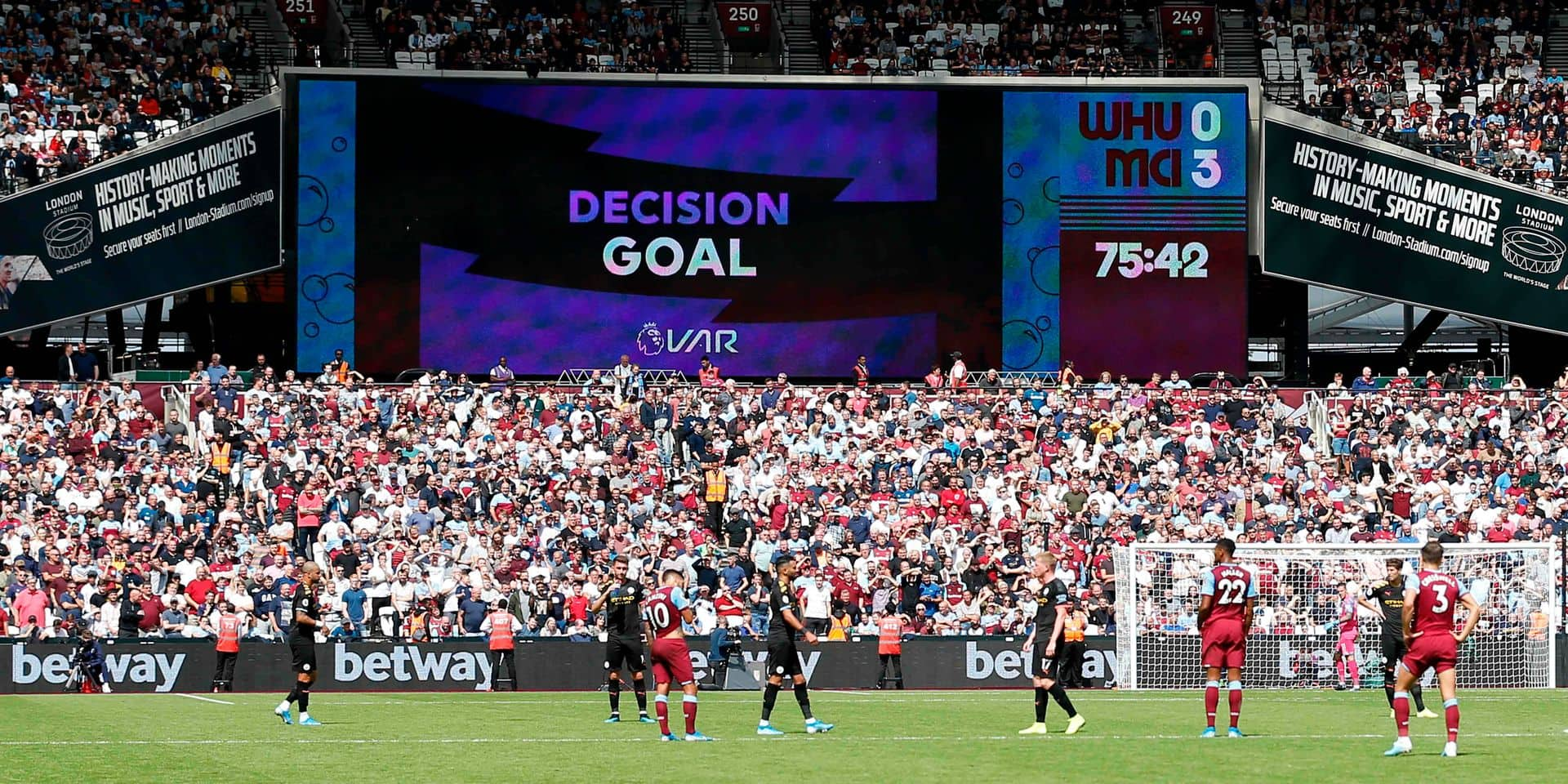 The big screen shows the VAR decision ruling Manchester City's third goal as valid during the English Premier League football match between West Ham United and Manchester City at The London Stadium, in east London on August 10, 2019. (Photo by Ian KINGTON / AFP) / RESTRICTED TO EDITORIAL USE. No use with unauthorized audio, video, data, fixture lists, club/league logos or 'live' services. Online in-match use limited to 120 images. An additional 40 images may be used in extra time. No video emulation. Social media in-match use limited to 120 images. An additional 40 images may be used in extra time. No use in betting publications, games or single club/league/player publications. /