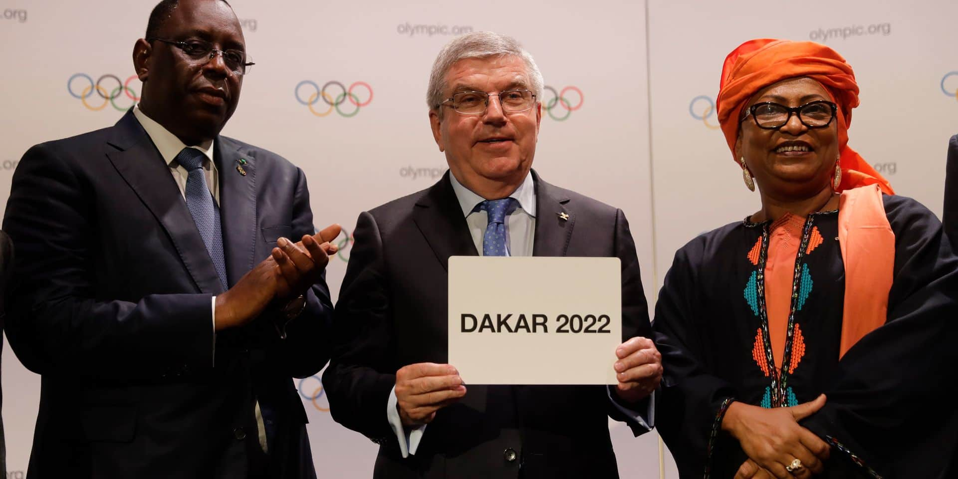 Senegal President Macky Sall, from left, and International Olympic Committee President Thomas Bach and Dakar Mayor Soham El Wardini, pose for a picture during the 133th IOC session in Buenos Aires, Argentina Monday, Oct. 8, 2018. Senegal will become the first African nation to host an Olympic event when in 2022 the nation will host the Youth Olympic Games. (AP Photo/Natacha Pisarenko, Pool)