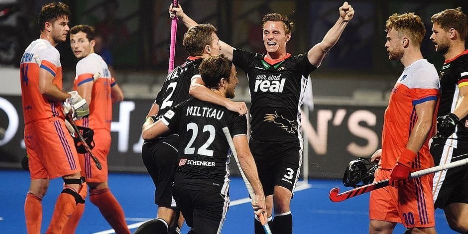 Germany's Mats Grambusch (C) with teammates celebrate a goal against Netherland during the field hockey group stage match between Germany and Netherland at the 2018 Hockey World Cup in Bhubaneswar on December 5, 2018. (Photo by Dibyangshu SARKAR / AFP)