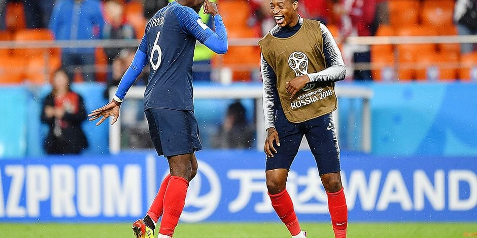 France's midfielder Paul Pogba (L) and France's defender Presnel Kimpembe celebrate victory during the Russia 2018 World Cup Group C football match between France and Peru at the Ekaterinburg Arena in Ekaterinburg on June 21, 2018. / AFP PHOTO / HECTOR RETAMAL / RESTRICTED TO EDITORIAL USE - NO MOBILE PUSH ALERTS/DOWNLOADS
