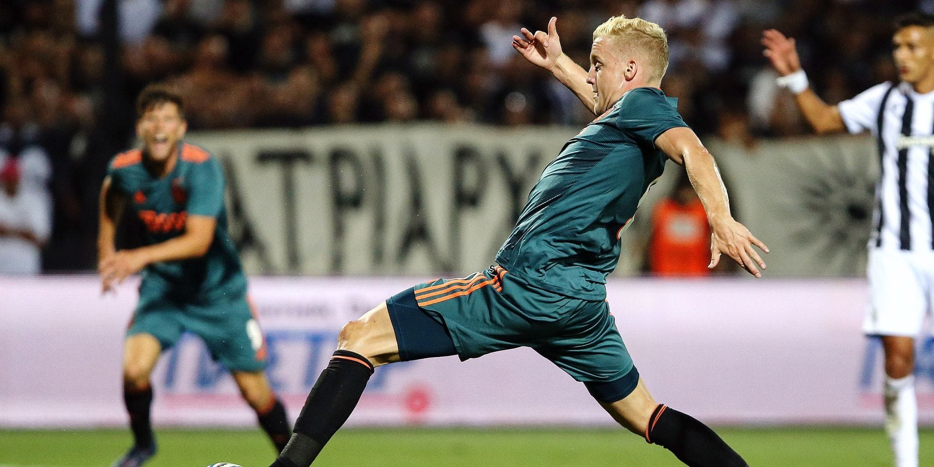 Ajax's Donny van de Beek runs with the ball during a Champions League third qualifying round, first leg soccer match between PAOK FC and AFC Ajax, at Toumba Stadium in the northern Greek port city of Thessaloniki, Tuesday, Aug. 6, 2019. (AP Photo/Giannis Papanikos)