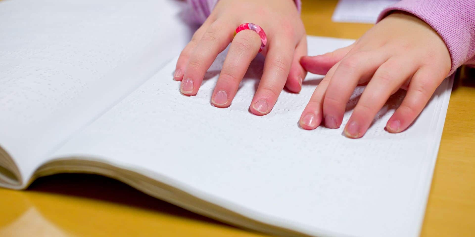 Blind girl reading braille
