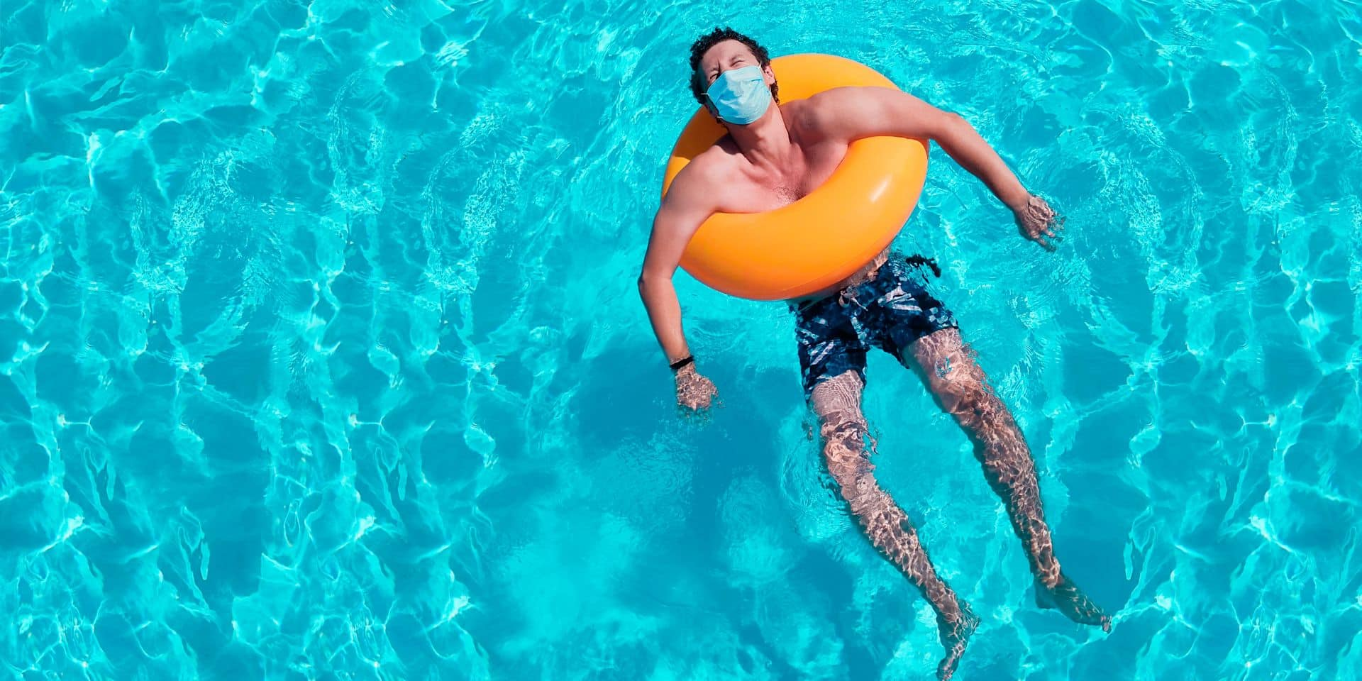 Young,Man,Is,Floating,In,The,Pool,With,A,Protective