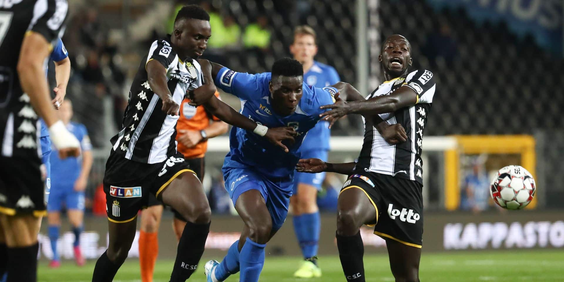 Charleroi's Modou Diagne, Genk's Paul Onuachu and Charleroi's Cristophe Diandy fight for the ball during a soccer match between Sporting Charleroi and Krc Genk, Friday 13 September 2019 in Charleroi, on the seventh day of the 'Jupiler Pro League' Belgian soccer championship season 2019-2020. BELGA PHOTO VIRGINIE LEFOUR