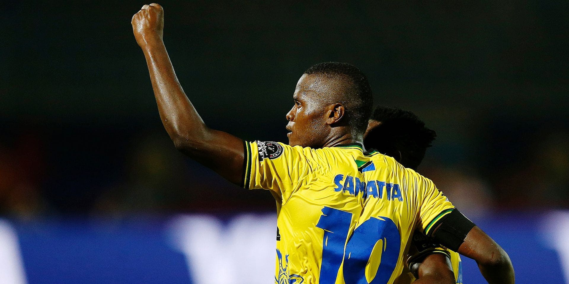 Tanzania's Mbwana Samatta celebrates after he scored during the African Cup of Nations group C soccer match between Kenya and Tanzania at 30 June Stadium in Cairo, Egypt, Thursday, June 27, 2019. (AP Photo/Ariel Schalit)