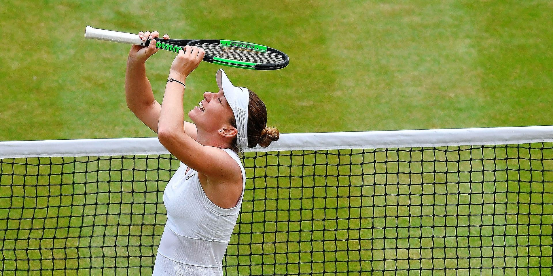 Romania's Simona Halep celebrates after beating Ukraine's Elina Svitolina in a Women's semifinal singles match on day ten of the Wimbledon Tennis Championships in London, Thursday, July 11, 2019. (Ben Stansall/Pool Photo via AP)