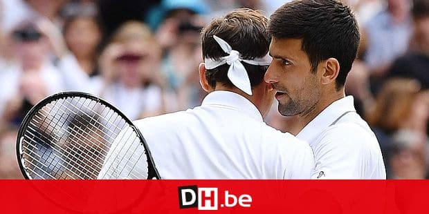 Serbia's Novak Djokovic (R) shakes hands with Switzerland's Roger Federer (L) after Djokovic won their men's singles final on day thirteen of the 2019 Wimbledon Championships at The All England Lawn Tennis Club in Wimbledon, southwest London, on July 14, 2019. (Photo by Ben STANSALL / AFP) / RESTRICTED TO EDITORIAL USE