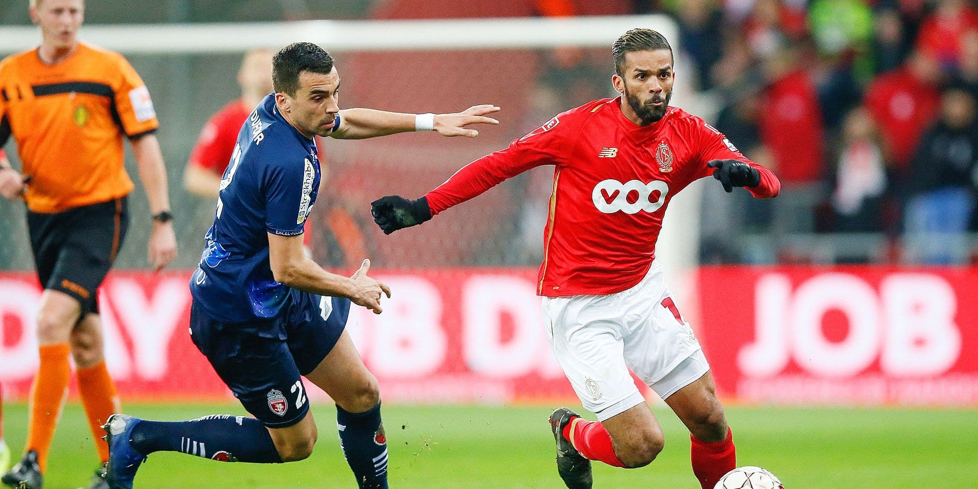 Mouscron's Noe Dussenne and Standard's Mehdi Carcela fight for the ball during a soccer game between Standard de Liege and Royal Excel Mouscron, Saturday 02 March 2019 in Liege, on the 28th day of the 'Jupiler Pro League' Belgian soccer championship season 2018-2019. BELGA PHOTO BRUNO FAHY