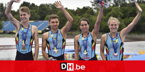 Belgian triathlete Marten Van Riel , Belgian triathlete Jelle Geens, Belgian triathlete Claire Michel and Belgian triathlete Valerie Barthelemy celebrate with the bronze medal at the Mixed Team Relay triathlon event at the European Championships, in Glasgow, Scotland, Saturday 11 August 2018. European championships of several sports will be held in Glasgow from 03 to 12 August. BELGA PHOTO ERIC LALMAND