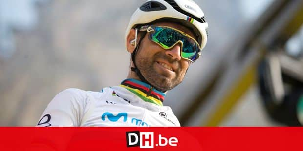 Spain's Alejandro Valverde from the Mobistar team stands on the podium during the team presentations for the Tour of Flanders cycling race in Antwerp, Belgium, Sunday, April 7, 2019. (AP Photo/Virginia Mayo)