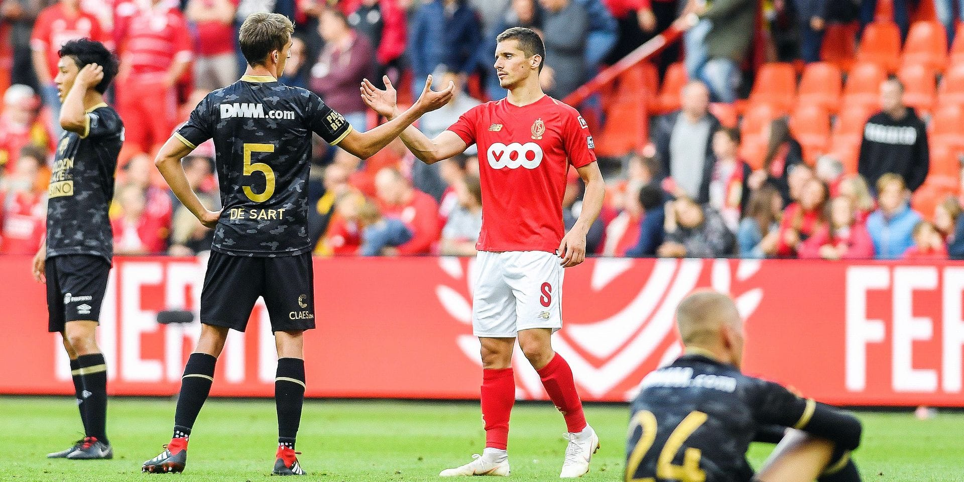 STVV's Alexis De Sart and Standard's Gojko Cimirot pictured after the Jupiler Pro League match between Standard de Liege and STVV, in Liege, Saturday 25 August 2018, on the fifth day of the Jupiler Pro League, the Belgian soccer championship season 2018-2019. BELGA PHOTO LAURIE DIEFFEMBACQ