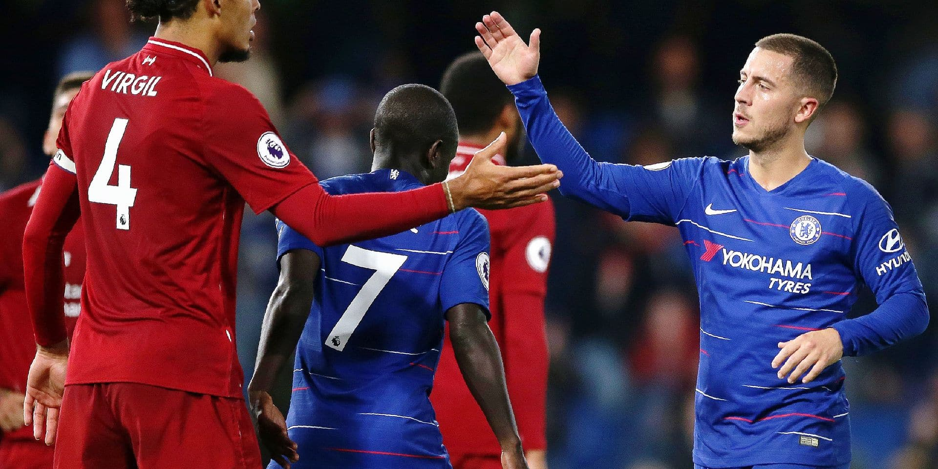 Liverpool's Dutch defender Virgil van Dijk (L) and Chelsea's Belgian midfielder Eden Hazard shake hands after the English Premier League football match between Chelsea and Liverpool at Stamford Bridge in London on September 29, 2018. (Photo by Daniel LEAL-OLIVAS / AFP) / RESTRICTED TO EDITORIAL USE. No use with unauthorized audio, video, data, fixture lists, club/league logos or 'live' services. Online in-match use limited to 120 images. An additional 40 images may be used in extra time. No video emulation. Social media in-match use limited to 120 images. An additional 40 images may be used in extra time. No use in betting publications, games or single club/league/player publications. /