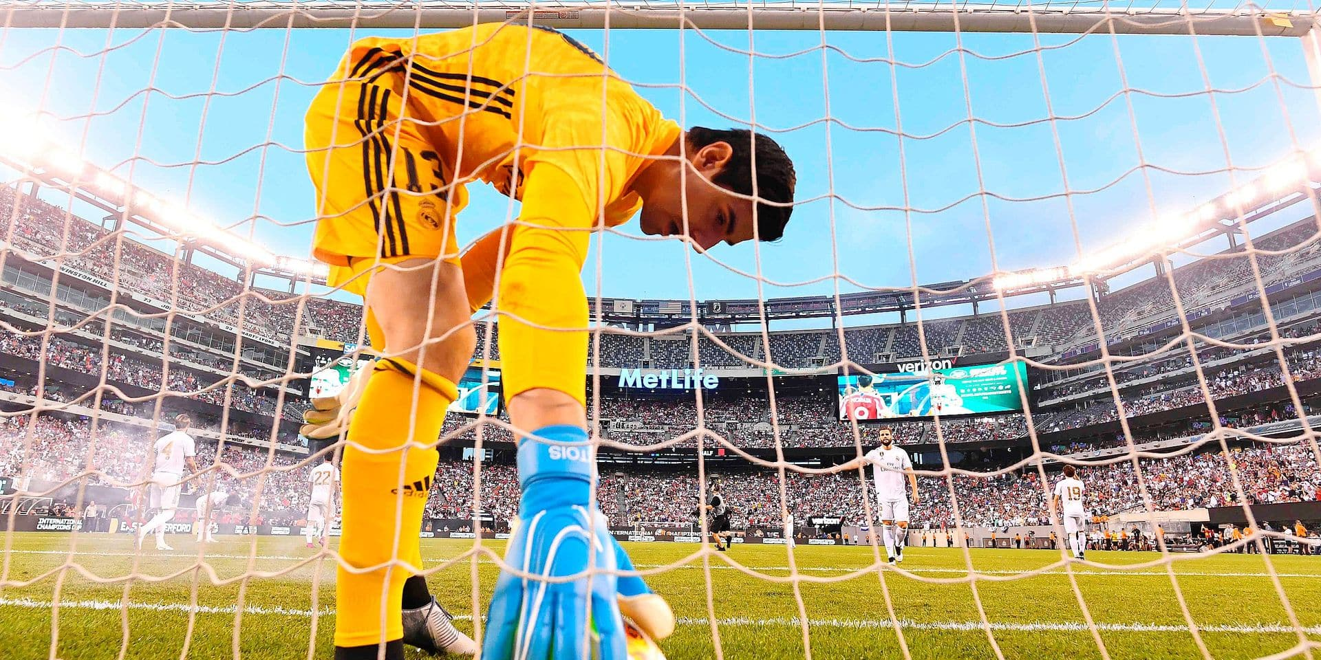 Real Madrid's Belgian goalkeeper Thibaut Courtois takes the ball after failing to save a goal during the 2019 International Champions Cup football match between Real Madrid and Atletico Madrid at the Metlife Stadium Arena in East Rutherford, New Jersey on July 26, 2019. (Photo by Johannes EISELE / AFP)