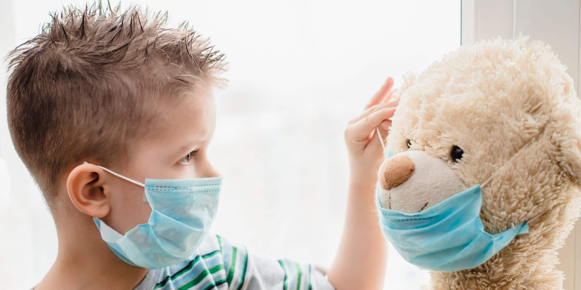 A,Small,Child,Helps,A,Teddy,Bear,Put,On,A