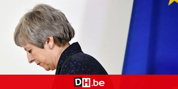 British Prime Minister Theresa May walks after holding a press conference on March 22, 2019, on the first day of an EU summit focused on Brexit, in Brussels. - European Union leaders meet in Brussels on March 21 and 22, for the last EU summit before Britain's scheduled exit of the union. (Photo by Emmanuel DUNAND / AFP)