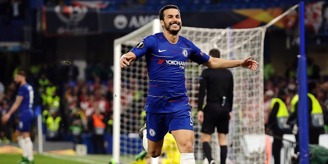 Chelsea's Pedro celebrates scoring his side's fourth goal during the Europa League quarterfinal, second leg, soccer match between Chelsea and Slavia Prague at Stamford Bridge stadium in London, Thursday, April 18, 2019. (AP Photo/Matt Dunham)