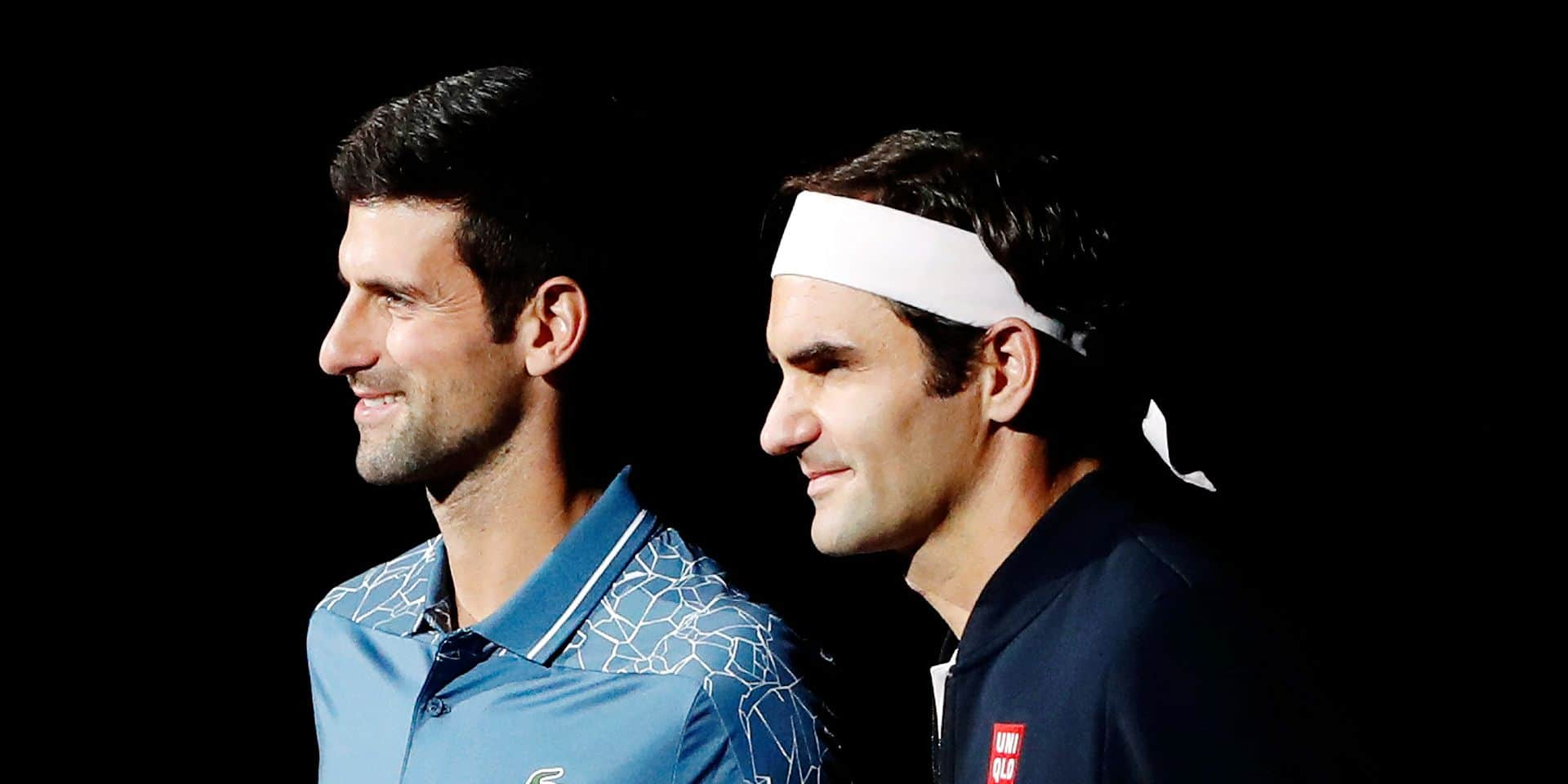 Roger Federer of Switzerland, left, and Novak Djokovic of Serbia pose prior to their semifinal match of the Paris Masters tennis tournament at the Bercy Arena in Paris, France, Saturday, Nov. 3, 2018. (AP Photo/Thibault Camus)
