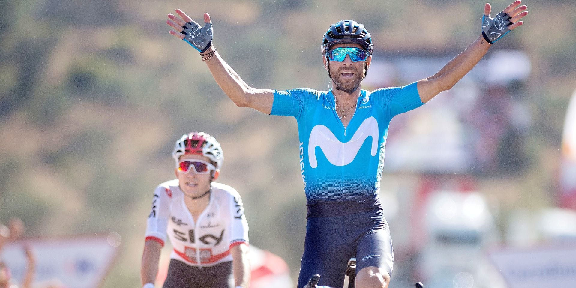 "Movistar's Spanish cyclist Alejandro Valverde (R) celebrates in Ardales winning the second stage of the 73rd edition of ""La Vuelta"" Tour of Spain cycling race, a 163,5 km route from Marbella to Caminito del Rey, ahead of today's second placed and leader of general classification Team Sky's Polish cyclist Michal Kwiatkowski (L), on August 26, 2018. (Photo by JORGE GUERRERO / AFP)"