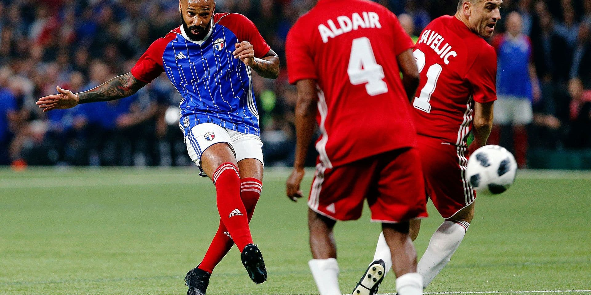 France's Thierry Henry, left, shots the ball past Aldair of Brazil, center, and Nisa Saveljic of Serbia, right, during a charity soccer match between members of the 1998 World Cup winning French team and a team of international veteran players who were also involved in the same tournament, at the U Arena in Nanterre, north of Paris, France, Tuesday, June 12, 2018. (AP Photo/Thibault Camus)