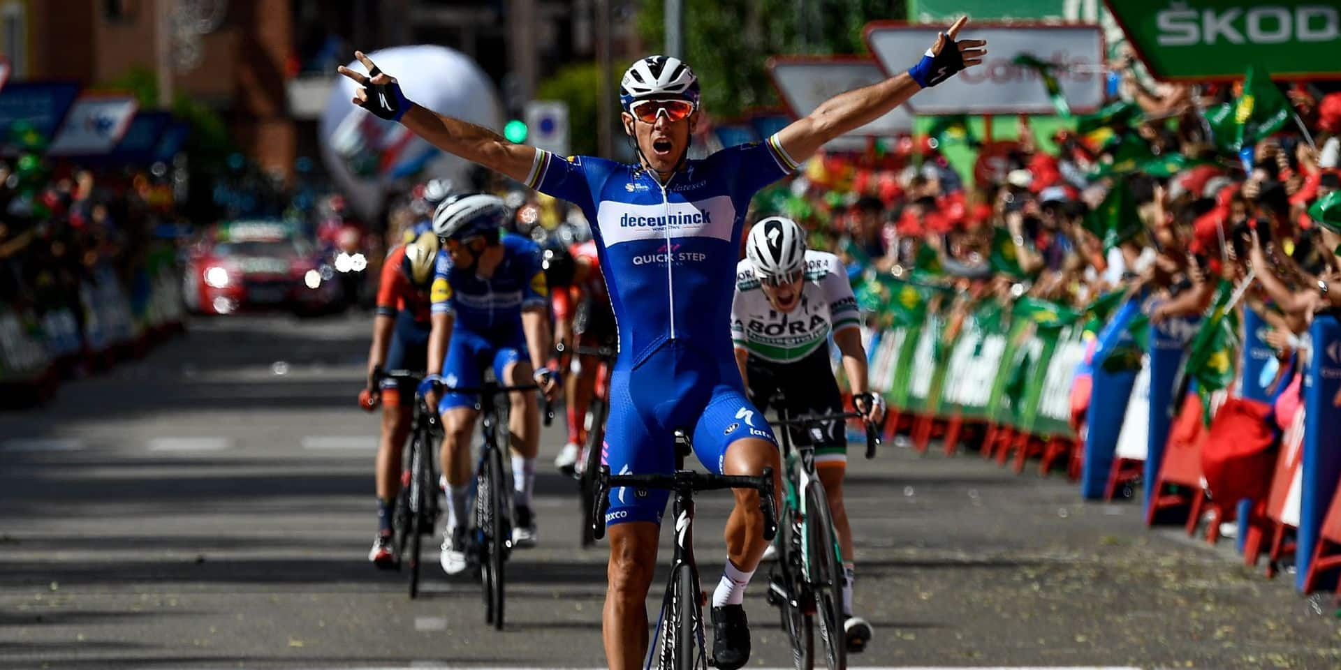 Team Deceuninck rider Belgium's Philippe Gilbert celebrates as he crosses the finish line and wins the 17th stage of the 2019 La Vuelta cycling Tour of Spain, a 219,6 km race from Aranda de Duero to Guadalajara on September 11, 2019. (Photo by OSCAR DEL POZO / AFP)