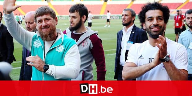 FILE - In this file photo from June 10, 2018, Egypt forward Mohamed Salah, right, and Chechnya's regional leader, Ramzan Kadyrov, greet soccer fans as they arrive to attend a team training session in Grozny, Russia. (AP Photo, File)